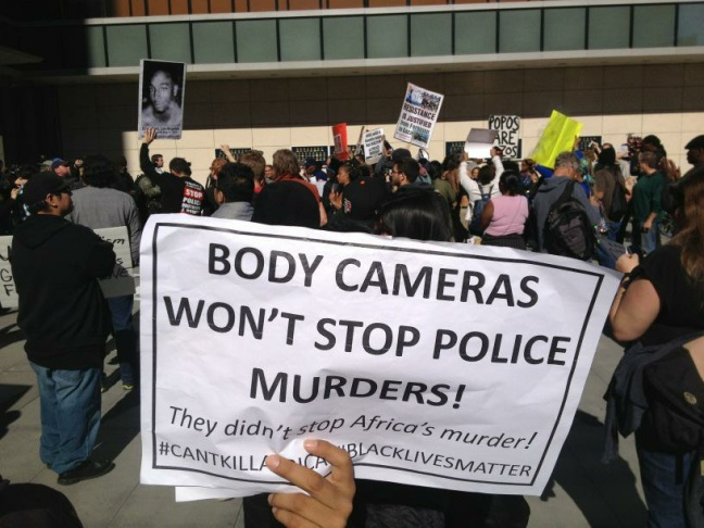 About 150 people protest fatal Skid Row LAPD shooting outside police headquarters Tuesday.