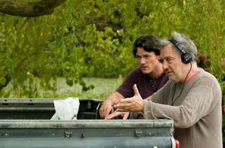Director Stephen Frears (R) with actor Luke Evans on the set of Tamara Drewe.
