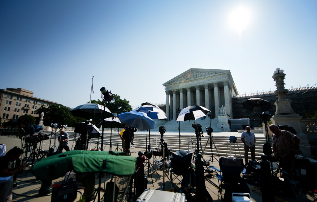 Members of the media camp outside the US Supreme Court June 21, 2012, in Washington, DC as the Supreme Court is expected to hand down its ruling.