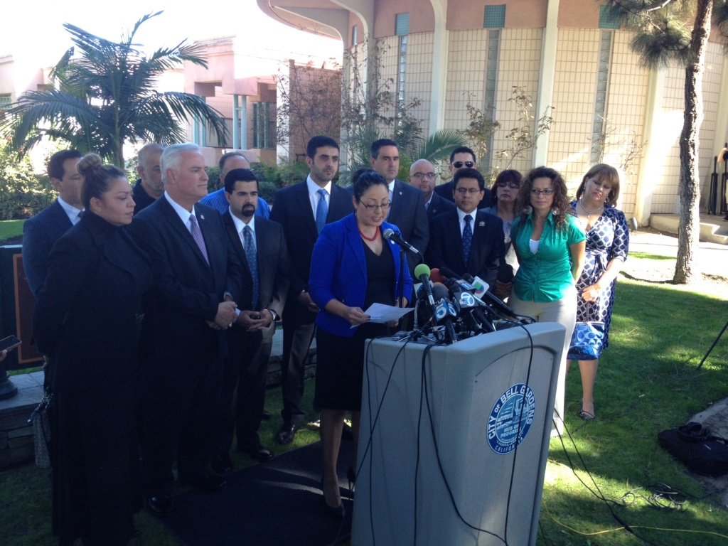 State Assemblywoman Cristina Garcia, at podium, led a group of Southeast L.A. elected officials who are calling for State Senator Ron Calderon to resign.