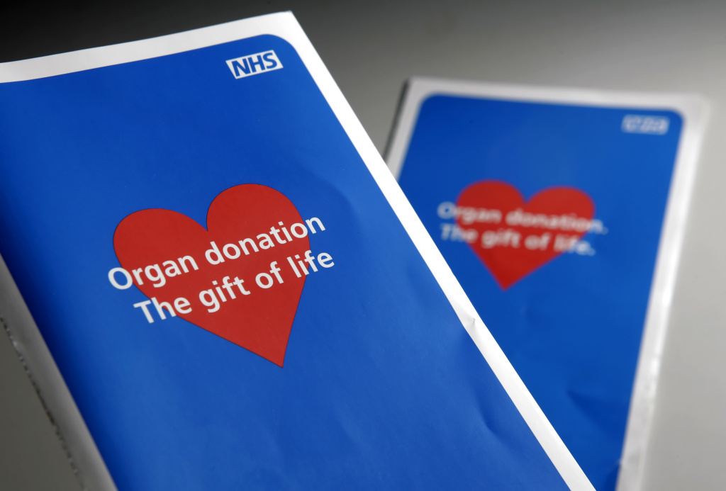 Two organ donor application leaflets shown in London on January 16, 2008.