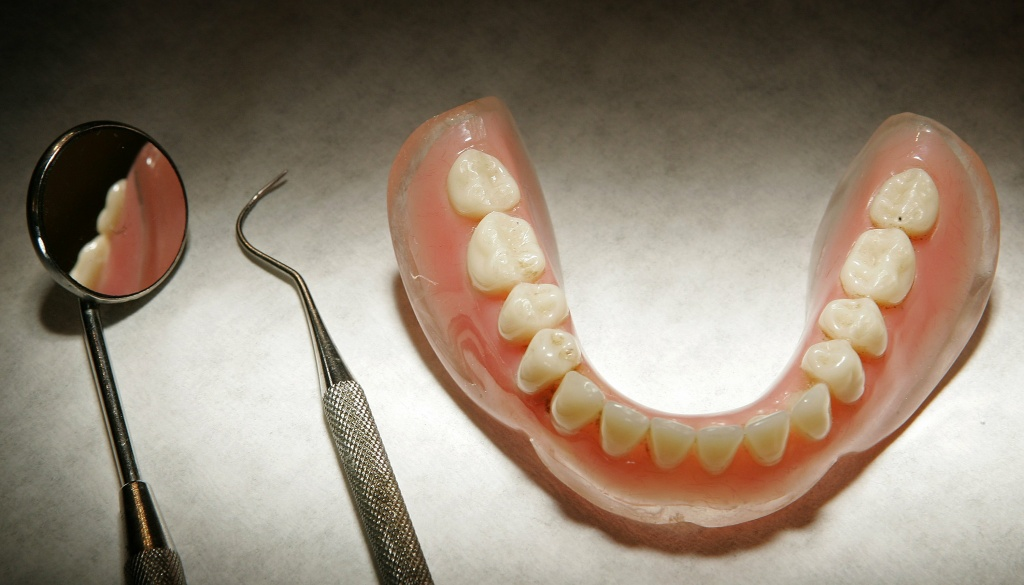 A denture model and dentist's tools are displayed on April 19, 2006 in Great Bookham, England