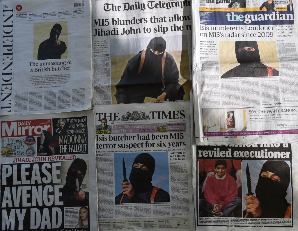 An arrangment of British daily newspapers photographed in London on February 27, 2015 shows the front-page headlines and stories regarding the identification of the masked Islamic State group militant dubbed