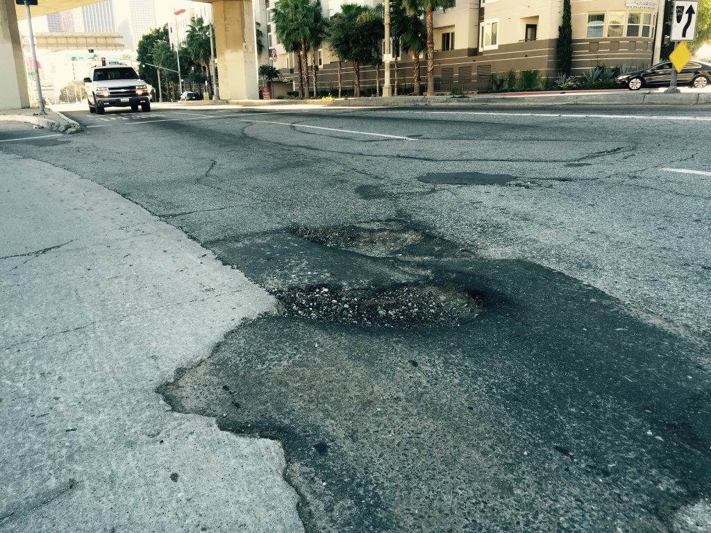 Two deep potholes at the corner of First Street and Glendale Boulevard near downtown L.A.