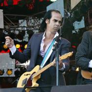 Australian singer Nick Cave (L) gestures