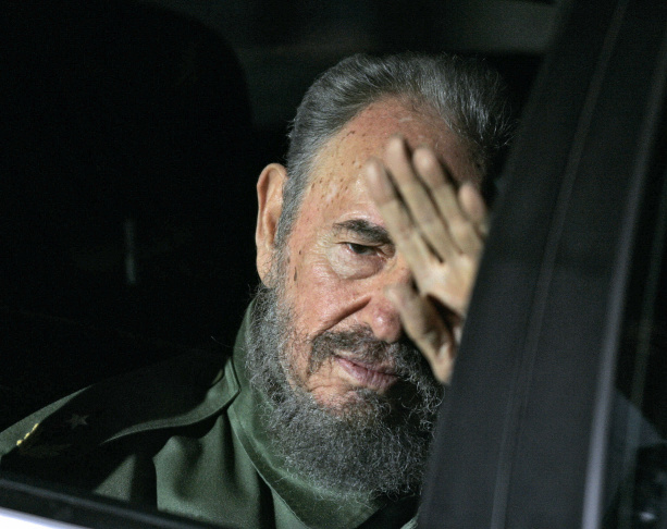 Cuba's President Fidel Castro waves to press upon his arrival in Cordoba, Argentina on July 20, 2006.