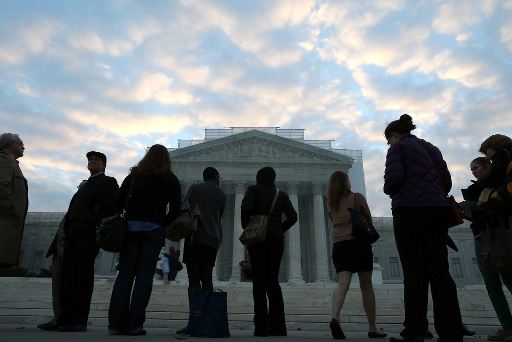 People wait in line to enter the U.S. Supreme Court on October 10, 2012 in Washington, DC.