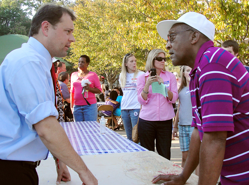 US Rep. Tom Perriello(L) D-VA, speaks to voter Charles Bailey during a campaign rally at Tonsler Park in Charlottesville, Virginia, on October 10, 2010.