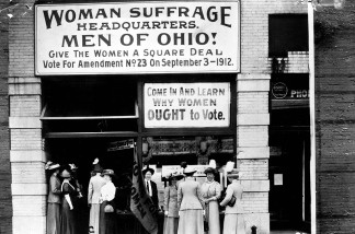 Woman suffrage headquarters in Upper Euclid Avenue, Cleveland. A. (at extreme right) is Miss Belle Sherwin, President, National League of Women Voters; B. is Judge Florence E. Allen (holding the flag); C. is Mrs. Malcolm McBride (1912)