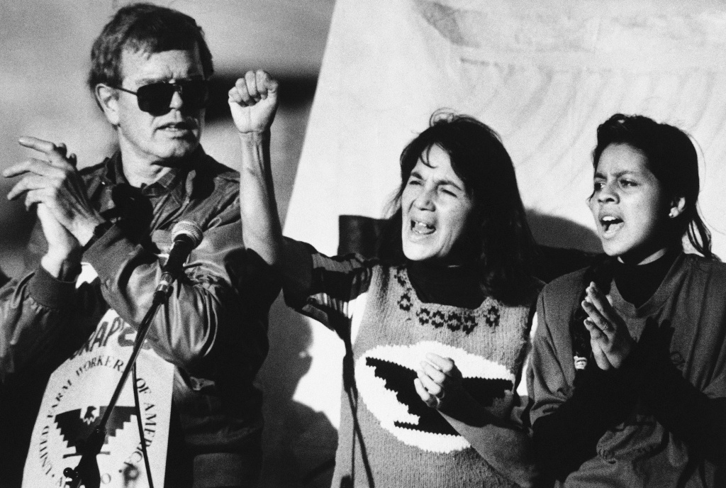United Farm Workers leader Dolores Huerta (center) leads a rally along with Howard Wallace, President of the San Francisco chapter of the UFW (left) and Maria Elena Chavez, 16, the daughter of Cesar Chavez (right) in San Francisco's Mission District on Nov. 19, 1988 as part of a national boycott of what the UFW claims is the dangerous use of pesticides on table grapes.