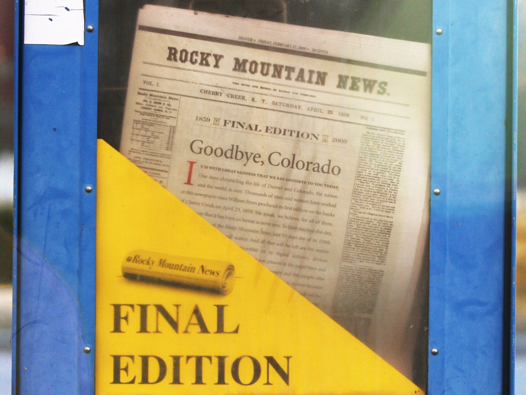 A copy of the final edition of the Rocky Mountain News sits in a newspaper box on a street corner in Denver, Colorado.