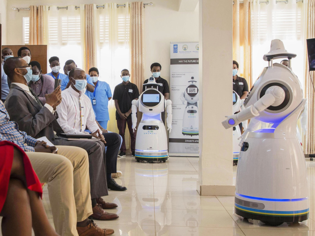 A robot introduces itself to patients in Kigali, Rwanda. The robots, used in Rwanda's treatment centers, can screen people for COVID-19 and deliver food and medication, among other tasks. The robots were donated by the United Nations Development Program and the <a href=