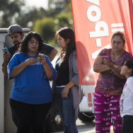 Local residents gather at East Orange Show Road and South Waterman Avenue near the Inland Regional Center in San Bernardino after a mass shooting on Wednesday, Dec. 2, 2015.