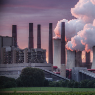 Power plant emits Carbon Dioxide pollution.