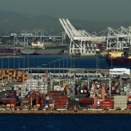 Ships wait to be loaded at the Port of Los Angeles in Long Beach on February 13, 2015.