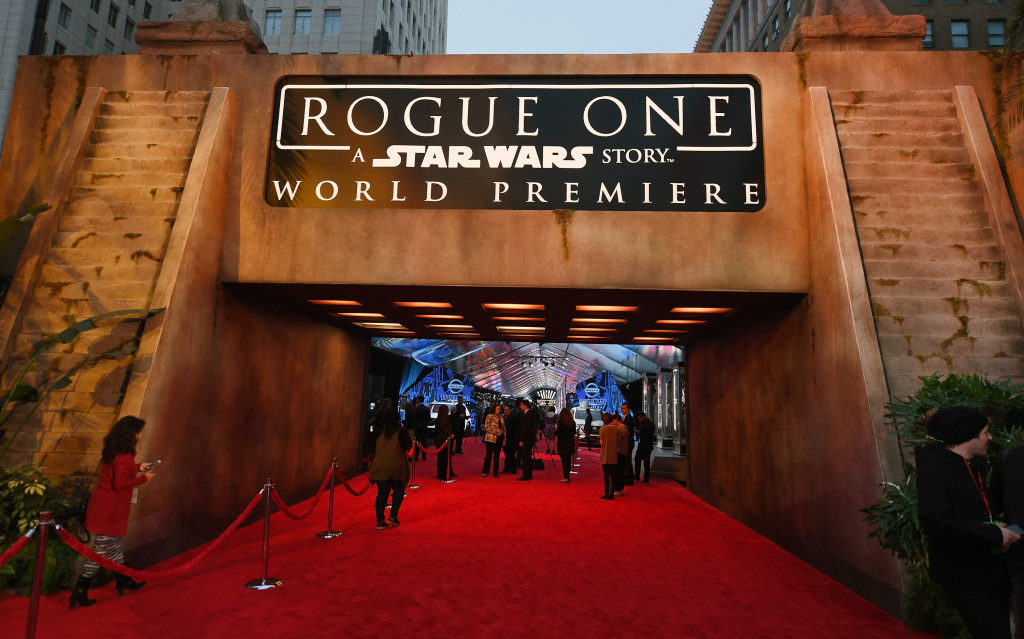 People walk near an entrance to the red carpet before the premiere of Walt Disney Pictures and Lucasfilm's