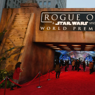 "People walk near an entrance to the red carpet before the premiere of Walt Disney Pictures and Lucasfilm's ""Rogue One: A Star Wars Story"" at the Pantages Theatre."