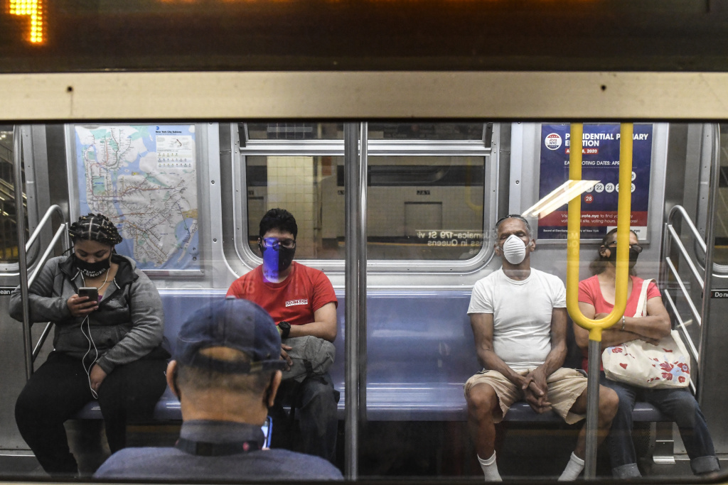 People commute on the subway in the Brooklyn borough on June 22, 2020 in New York City.