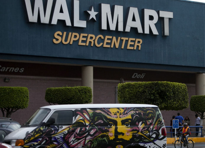 A van covered by a mural sits parked outside a Wal-Mart Super Center in Mexico City. Wal-Mart Stores Inc. hushed up a vast bribery campaign that top executives of its Mexican subsidiary carried out to build stores across Mexico, according to a published report by the New York Times. On Thursday, U.S. lawmakers released emails that show that Wal-Mart Stores Inc.'s CEO found out in 2005 that the retailer was handing out bribes in Mexico.