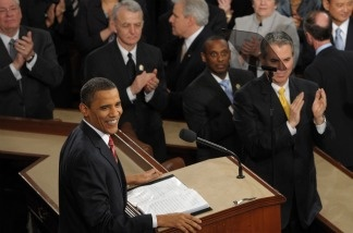 President Barack Obama is applauded prior to delivering his first State of the Union address Jan. 27, 2010 at the US Capitol in Washington, DC. This year, against custom, Democrats and Republicans will intermingle instead of sitting on opposite sides of the House.
