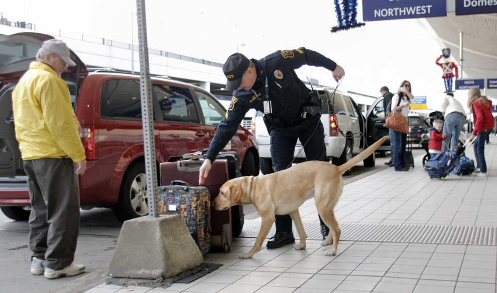 Cpl. Frederick (No first name given) of the Wayne County Airport Police and his dog Spencer patrol at the Detroit Metropolitan Airport December 26, 2009 in Romulus, Michigan.