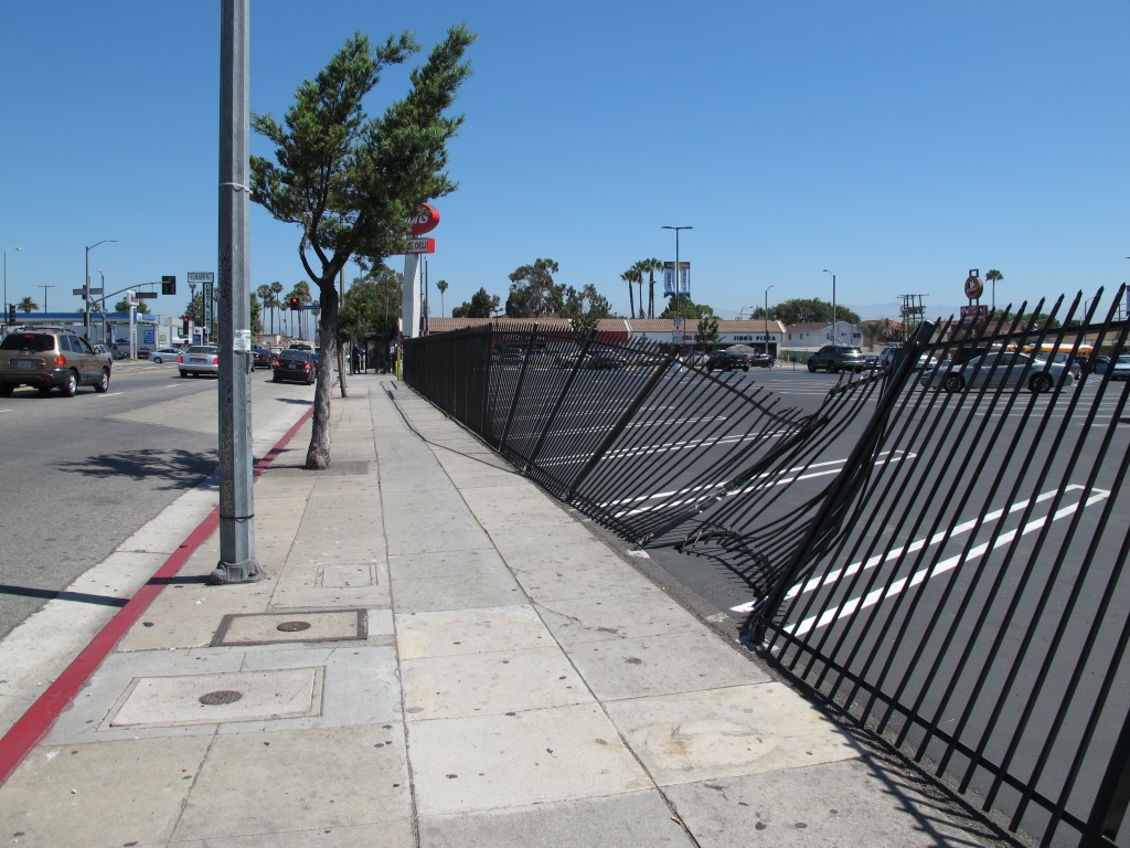 Iron fences like these are a regular feature in South L.A. to protect businesses from car crashes, but this one was mangled in a recent collision on Western Avenue near Manchester Avenue.