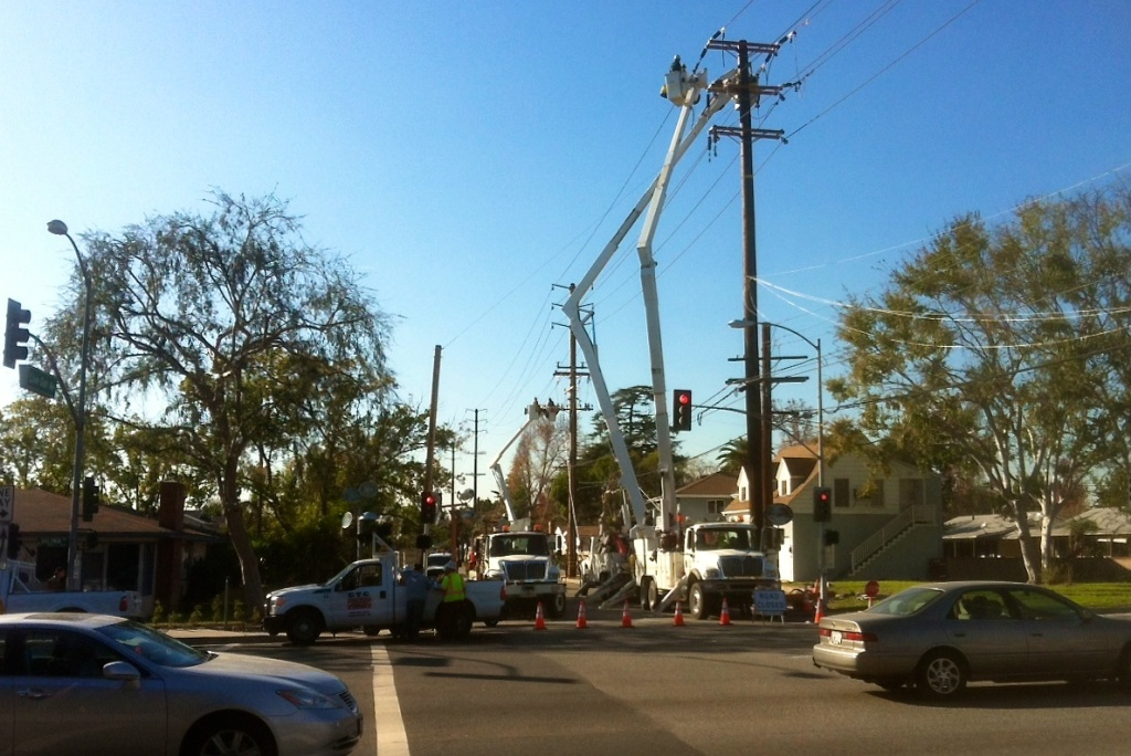 Southern California Edison employees work to restore power near the intersection of Live Oak and Baldwin avenues in Temple City following the 2011 windstorms.
