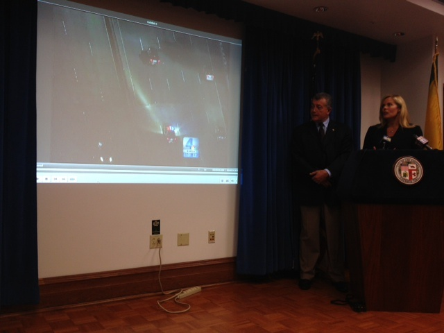 L.A. City Attorney Carmen Trutanich and deputy city attorney Denise Mills show TV news helicopter video from the April 11 police shooting of Abdul Arian at news conference announcing that the lawsuit was dismissed.