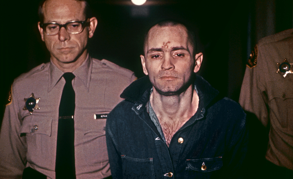 Beardless and shaven-headed, Charles Manson, is sullen faced as he goes to hear sentence of death in the gas chamber passed by the court 29 March 1971 in Los Angeles. Manson was convicted of murder, after in August 1969, during two bloody evenings of paranoid, psychedelic savagery, at least nine people were murdered among them Sharon Tate, the young and pregnant actress and wife of Roman Polanski. The trial of Manson and three girls followers similarly sentenced lasted ten months.