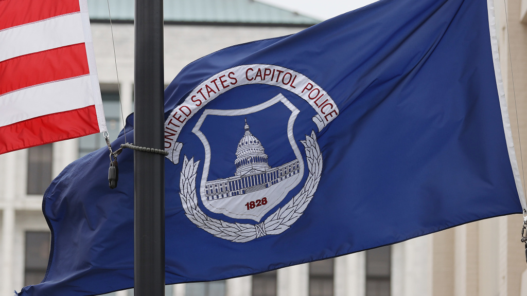The U.S. and U.S. Capitol Police flags were flown at half-staff after the death of officer Brian Sicknick. On Sunday, the FBI arrested two men who are accused of spraying chemicals on Sicknick and others.
