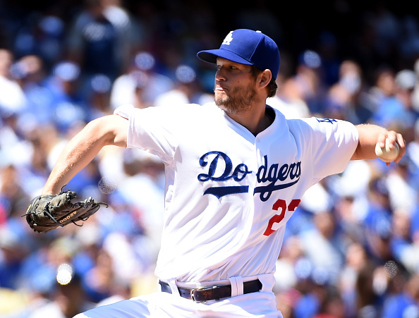 LOS ANGELES, CA - APRIL 06:  Clayton Kershaw #22 of the Los Angeles Dodgers pitches to the San Diego Padres in the first inning during opening day at Dodger Stadium on April 6, 2015 in Los Angeles, California.  (Photo by Harry How/Getty Images)