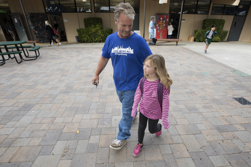 Bob Patterson picks up his daughter from school in Lomita, California, on Oct. 30, 2017.