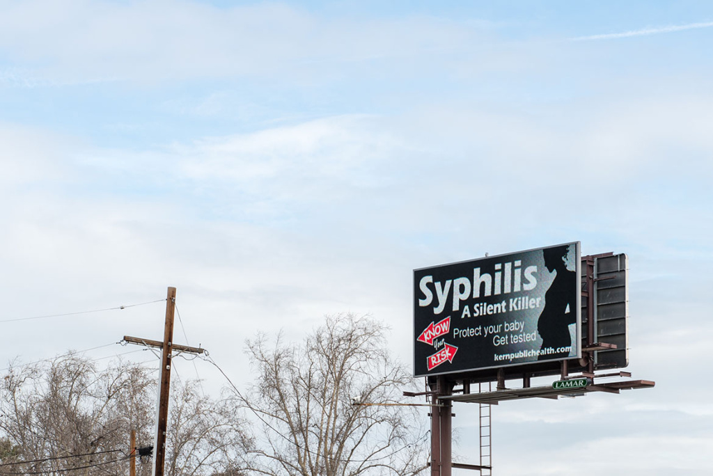 An electronic billboard near downtown Bakersfield displays a public service announcement about sexually transmitted diseases. The Kern County public health department has embarked on a massive information campaign with the slogan
