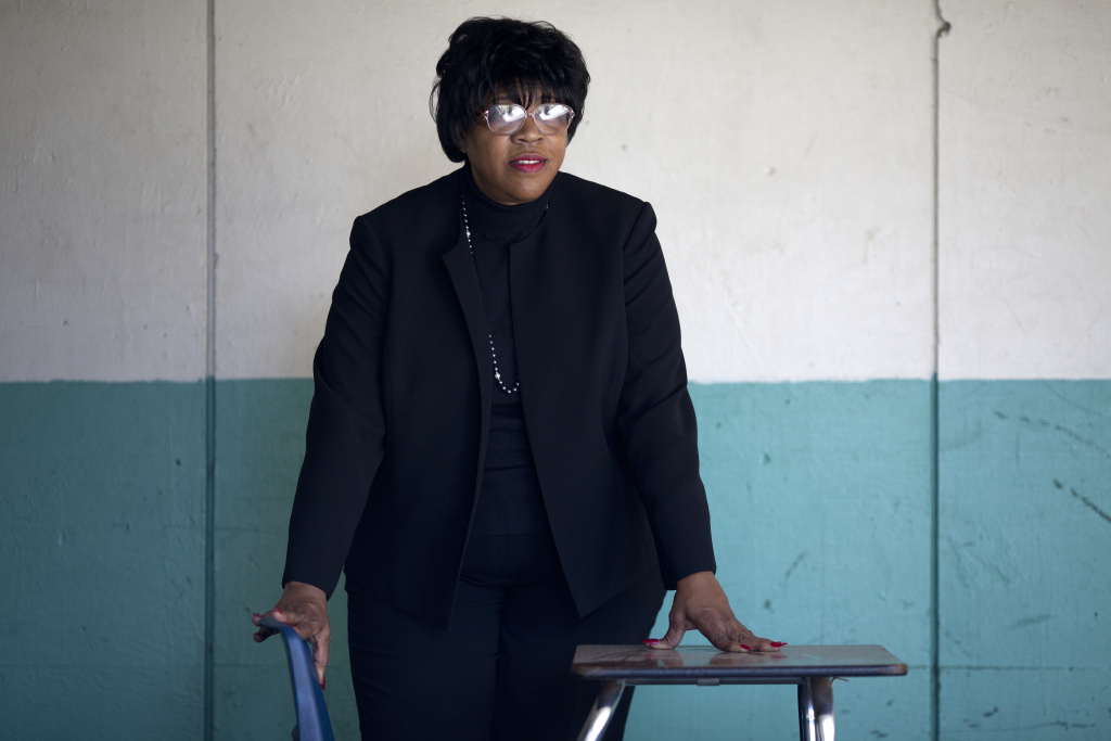 Joyce Randall stands in the hallway near her old classroom at Inglewood High School. Documents and interviews show the distribution of a negative flier when she ran for school board was paid for with school district funds.