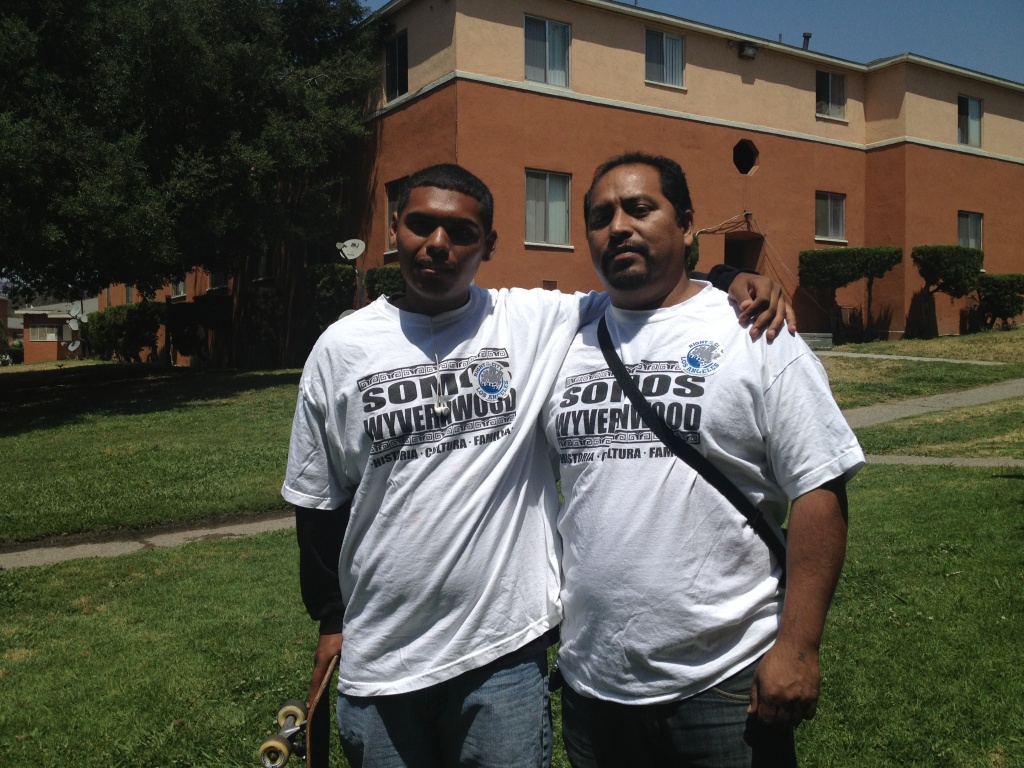 Miguel Meneses Sr. (right) and his son have lived in the Wyvernwood Garden Apartments in Boyle Heights for nearly 20 years. Both fear a planned redevelopment of the apartment complex may make their unit less affordable. But the developer has promised options, including keeping the rental rates the same.