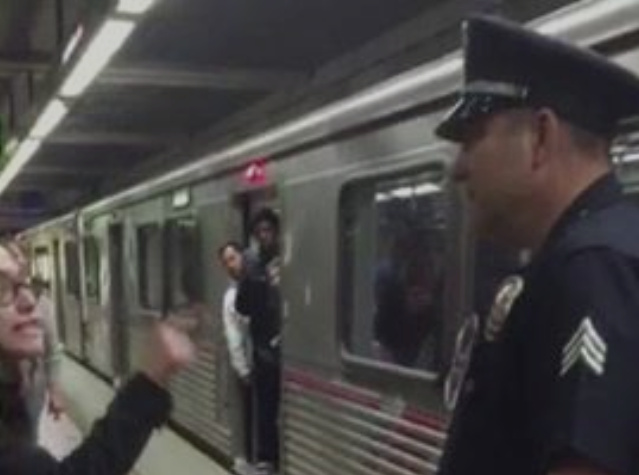 A video posted to Facebook shows a Los Angeles police officer pulling a young woman off the subway. She can be heard complaining that she was removed for having her feet on the seat.