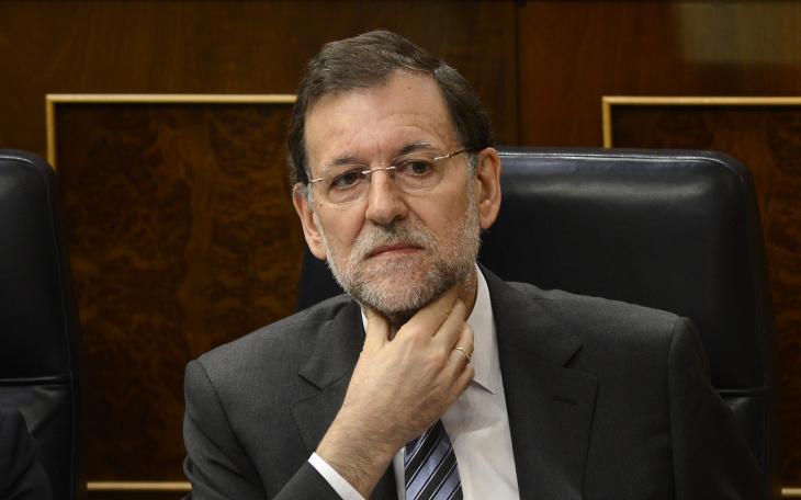 Spain's Prime Minister Mariano Rajoy ges
