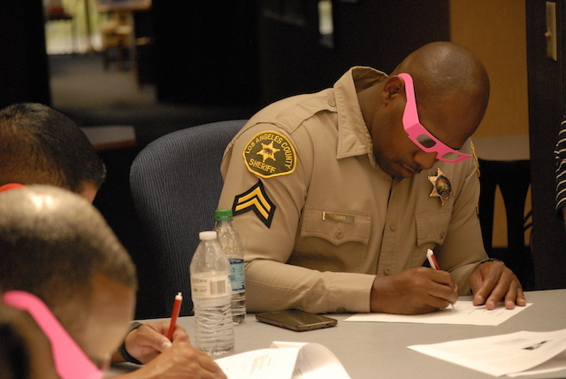 As part of a training exercise on autism, Los Angeles County Sheriff's Deputy Ralphael Banks donned 3D glasses and wrote with his right hand instead of his dominant left while taking a quiz. The object was to acquaint deputies with the sensory confusion and frustration many autistic people face.