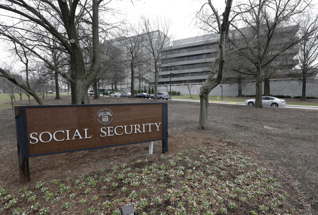 The Social Security Administration's main campus is seen in Woodlawn, Md. Millions of Social Security recipients and federal retirees will get only tiny increases in benefits next year.