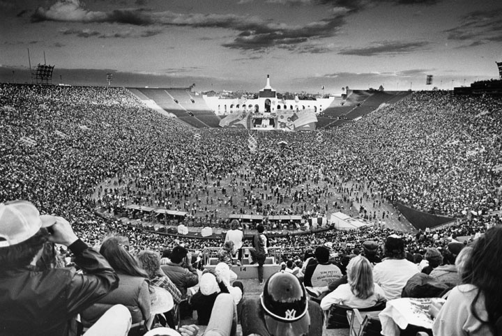 October 12, 1981 shows a paramount view of crowds at the Rolling Stones concert at the Los Angeles Coliseum with the concert stage in the distance.