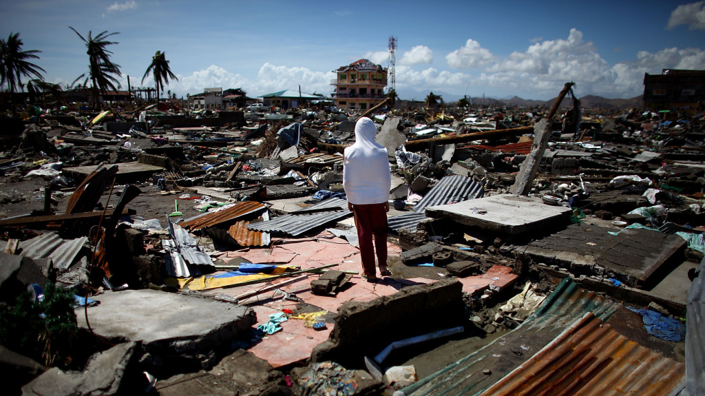 A boy stands in the ruins of the leveled a neighborhood in Tacloban. Food and water supplies were almost non-exsistent in the days immediately after the storm.