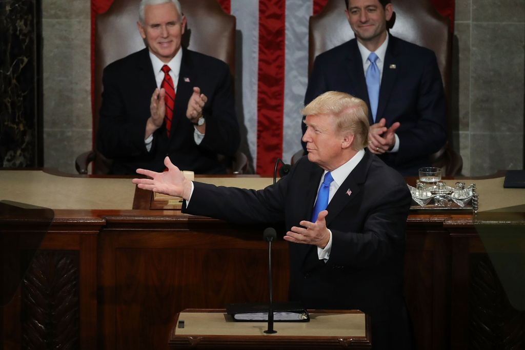 U.S. President Donald J. Trump delivers the State of the Union address as U.S. Vice President Mike Pence (L) and Speaker of the House U.S. Rep. Paul Ryan (R-WI) (R) look on in the chamber of the U.S. House of Representatives January 30, 2018 in Washington, DC.