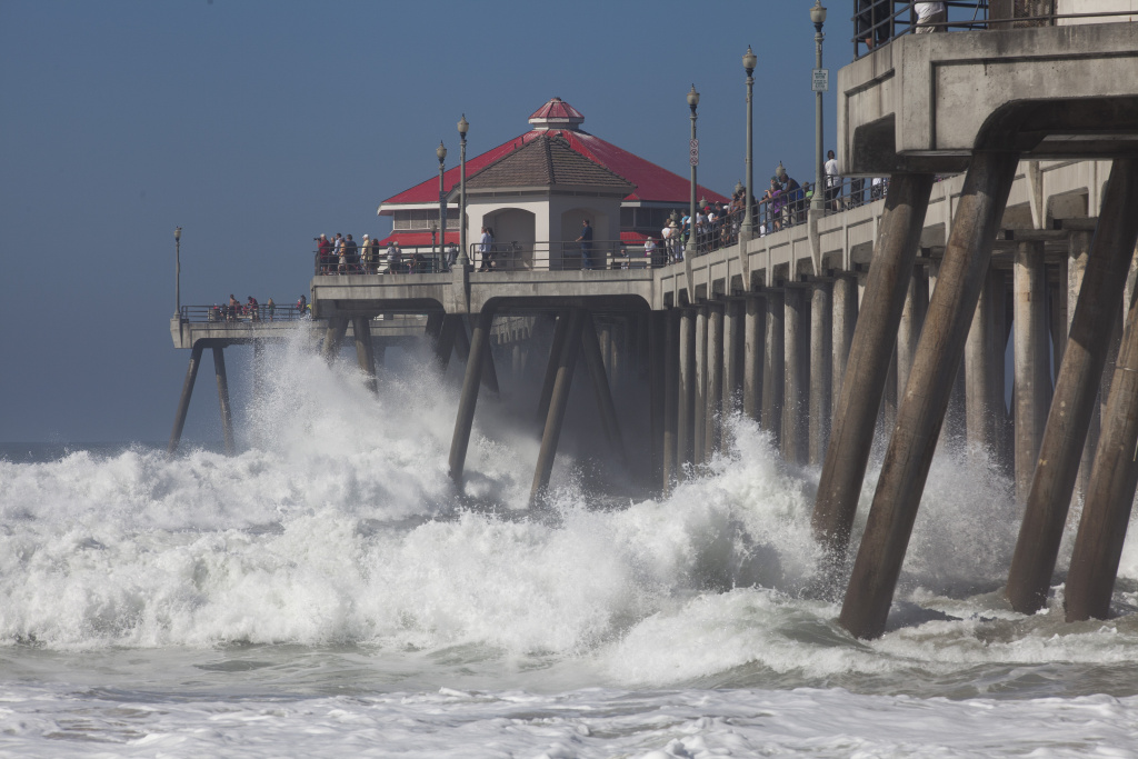 Big waves crash under the Huntington Beach Pier as Hurricane Marie brings a swell toward to the Southern California coast.