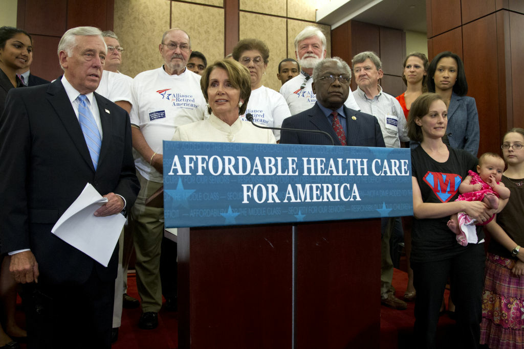 House Minority Leader Nancy Pelosi of Calif., flanked by House Minority Whip Steny Hoyer of Md., left, and House Assistant Minority Leader James Clyburn of S.C., speaks about the Affordable Care Act, Wednesday, July 11, 2012, on Capitol Hill in Washington.