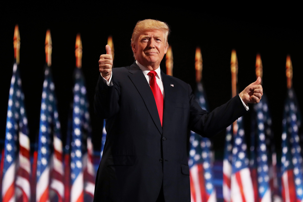 File: Republican then-presidential candidate Donald Trump gives two thumbs up to the crowd during the evening session on the fourth day of the Republican National Convention on July 21, 2016 at the Quicken Loans Arena in Cleveland, Ohio.