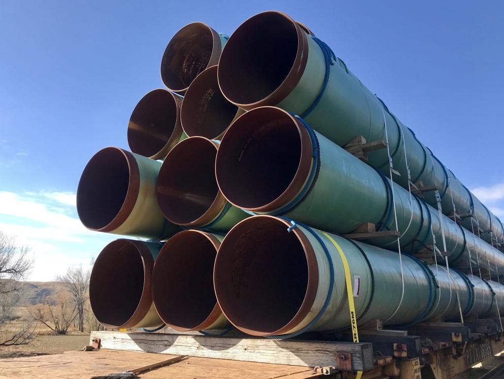 Keystone XL pipeline sections sit on a train near Glendive, Mont.