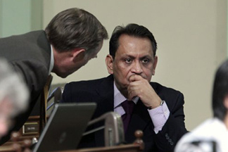 Assemblyman Jared Huffman, D-San Rafael, left, talks with Assembly member Gil Cedillo, D-Los Angeles, at the Capitol last year.