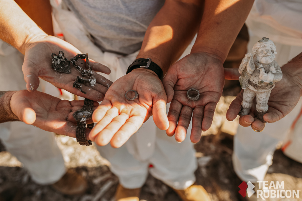 Team Rubicon volunteers sift through ash from the Lilac Fire in San Diego and find jewelry and a Christmas ornament.