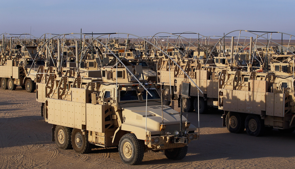 U.S. Army armored vehicles are seen lined up as they wait to be shipped to their next destination after they exited from Iraq on December 14, 2011 at Camp Virginia, near Kuwait City, Kuwait.