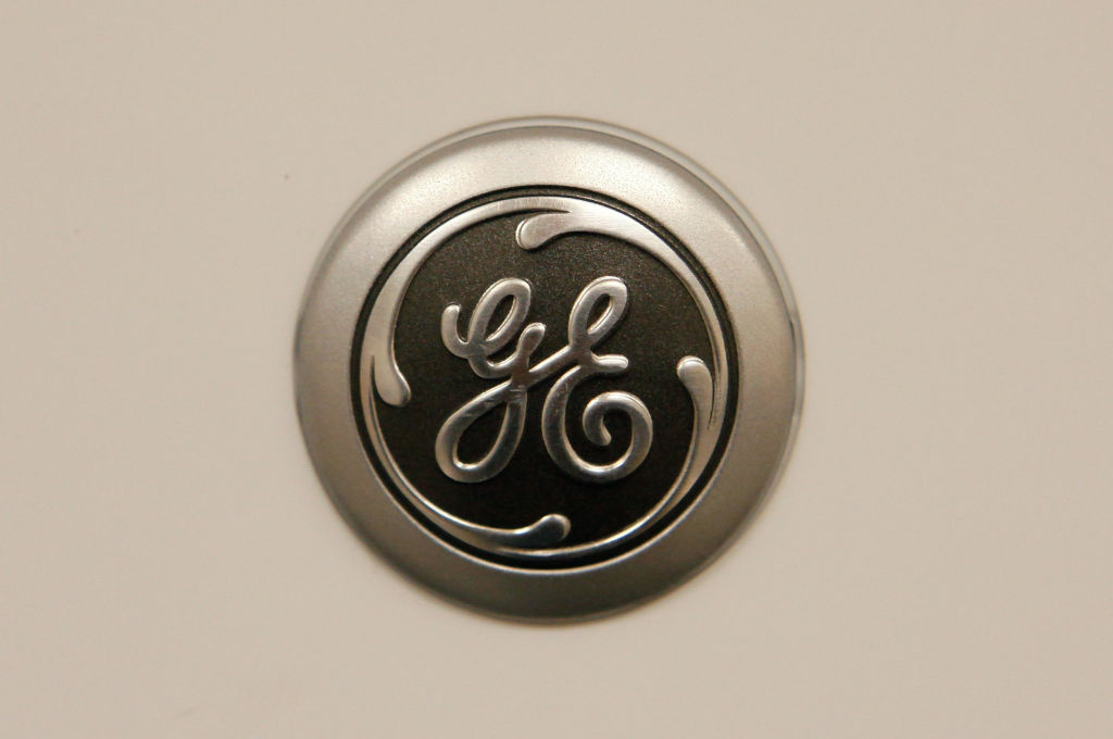 A General Electric Co. (GE) logo is displayed on the door of one of the company's microwave ovens being offered for sale at a Sears store January 22, 2010 in Chicago, Illinois. Today GE posted a 19% slump in fourth-quarter earnings, but still beat Wall Street expectations.